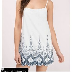 Spaghetti strap white dress with blue embroidery